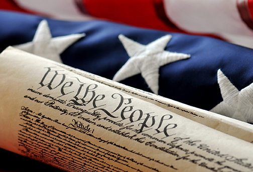 Constitution in front of American flag